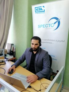 Photograph of of trainer leading an online 'Train the Trainer' session for Specto