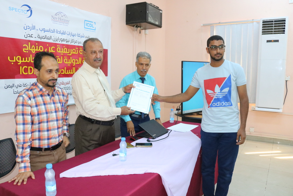Photo of an ICDL candidate receiving his certificate at a test centre in Yemen.