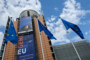 Photo of large banner on European Commission headquarters in Brussels.
